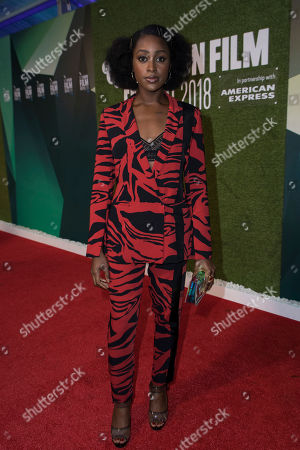 Simona Brown poses for photographers upon arrival at the premiere for the film 'The Little Drummer Girl' showing as part of the BFI London Film Festival in London