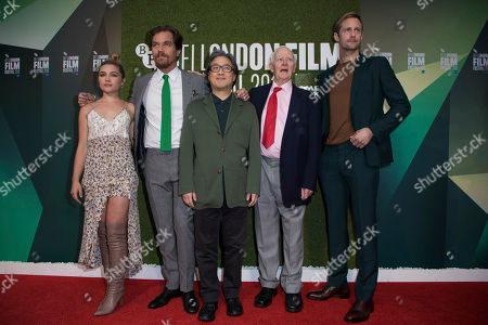 Florence Pugh, Michael Shannon, Park Chan-wook, John le Carre, Alexander Skarsgard. From left, Florence Pugh, Michael Shannon, Park Chan-wook, John le Carre and Alexander Skarsgard pose for photographers upon arrival at the premiere for the film 'The Little Drummer Girl' showing as part of the BFI London Film Festival in London