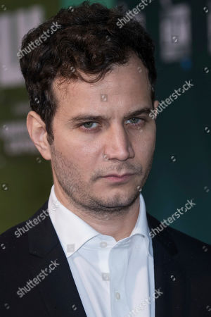 Michael Moshonov poses for photographers upon arrival at the premiere for the film 'The Little Drummer Girl' showing as part of the BFI London Film Festival in London