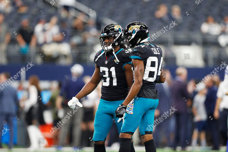 Jacksonville Jaguars running back Jamaal Charles (31) and wide receiver Keelan Cole (84) during warm-ups before an NFL football game against the Dallas Cowboys in Arlington, Texas