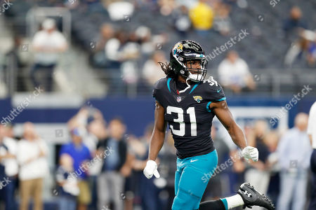 Jacksonville Jaguars running back Jamaal Charles (31) warm-ups before an NFL football game against the Dallas Cowboys in Arlington, Texas