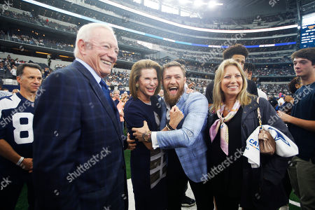 L to R) Dallas Cowboys owner Jerry Jones, Susan G. Komen for the Cure Founder Nancy Brinker and UFC fighter Conor McGregor pose for photos before an NFL football game against the Jacksonville Jaguars in Arlington, Texas