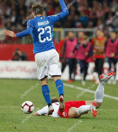 Poland's Jakub Blaszczykowski is takled by Italy's Nicolo' Barella during the UEFA Nations League soccer match between Poland and Italy at the Silesian Stadium Chorzow, Poland