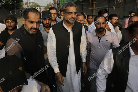 Shahid Khaqan Abbasi, former Prime Minister arrives to cast his ballot at a polling station during by-elections in Lahore, Pakistan, 14 October 2018. Over 100 candidates are vying for 35 national and provincial assembly seats, which were vacant after the general elections, according to the Election Commission of Pakistan (ECP).