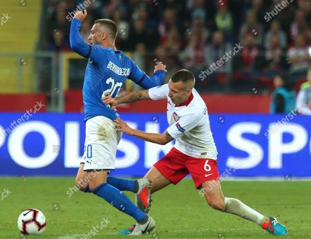 Jacek Goralski (R) of Poland in action against  Federico Bernardeschi (L) of Italy during the UEFA Nations League soccer match between Poland and Italy, in Chorzow, Poland, 14 October 2018.