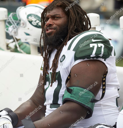 Stock Photo of East Rutherford, New Jersey, U.S. - New York Jets offensive guard James Carpenter (77) on the sideline during a NFL game between the Indianapolis Colts and the New York Jets at MetLife Stadium in East Rutherford, New Jersey. The Jets defeated the Colts 42-34