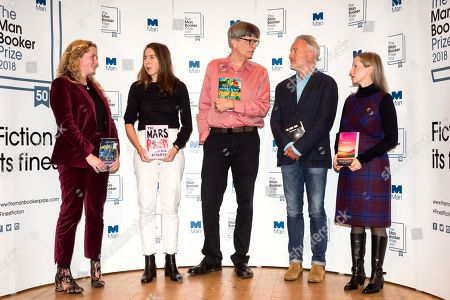 Authors Daisy Johnson, Rachel Kushner, Richard Powers, Robin Robertson and Anna Burns pose with their books during a photocall at the Royal Festival Hall, two days ahead of the announcement of the winning book of the 2018 Man Booker Prize.