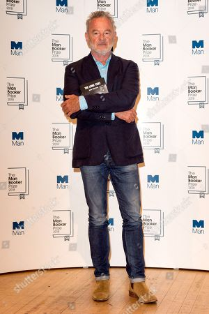 Author Robin Robertson poses with his book The Long Take during a photocall at the Royal Festival Hall, two days ahead of the announcement of the winning book of the 2018 Man Booker Prize.