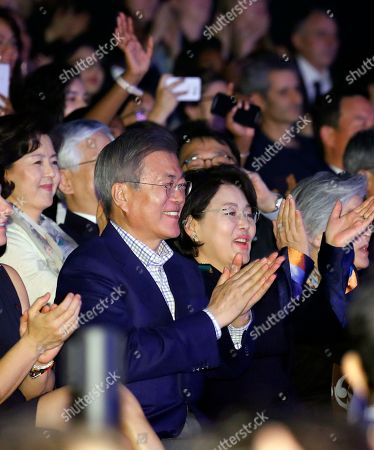 South Korean President Moon Jae-in and first lady Kim Jung-soo clap while watching South Korean boy band BTS perform during a Korea-France friendship concert in Paris, France, 14 October 2018 (issued 15 October 2018). Moon is in Paris for a four-day state visit.