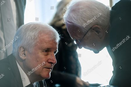 German Minister of Interior, Construction and Homeland Horst Seehofer (L) and Honorary Chairman of the Christian Social Union (CSU) party, Edmund Stoiber (R), talk during a CSU board meeting on the day after the Bavaria state elections, in Munich, Germany, 15 October 2018. The CSU lost significant in the 14 October regional elections in Bavaria and gained - according to the provisional official result - a 37,2 percent of the votes but remains the strongest faction in the new Bavarian parliament.