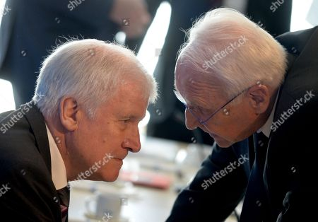 German Minister of Interior, Construction and Homeland and Christian Social Union (CSU) party chairman, Horst Seehofer (L) and Honorary Chairman of the Christian Social Union (CSU) party, Edmund Stoiber (R), speak prior to the CSU board meeting one day after the Bavaria state elections, in Munich, Germany, 15 October 2018. The CSU lost 10.5 percent of their votes compared to the result of the last election in Bavaria in the year 2013.
