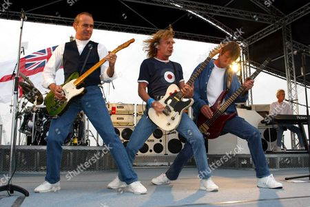 Status Quo Perform Songs From Their New Album 'heavy Traffic' Aboard Hms Ark Royal In Portsmouth Docks.they Are From Left; Francis Rossi Rick Parfitt John 'rhino' Edwards Andrew Bown And Matt Letley (on Drums)