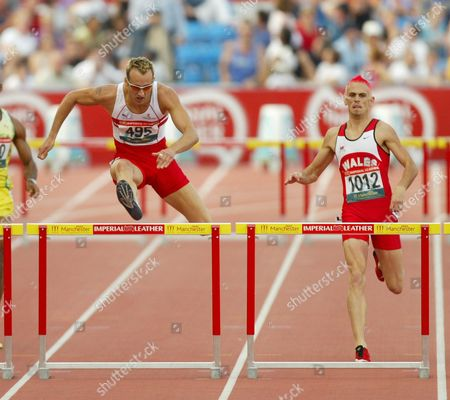 17th Commonwealth Games Manchester 2002.mens 400m Hurdles Final. Chris Rawlinson Of England (495) And Matthew Elias Of Wales (1012) In Action. Rawlinson Won The Gold Elias The Silver.