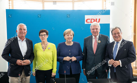 (L-R) The vice-chairman of the Christian Democratic Union (CDU), Thomas Strobl, Secretary General Annegret Kramp-Karrenbauer, German Chancellor Angela Merkel, Deputy Leader of the Christian Democratic Union (CDU) Volker Bouffier and Armin Laschet (C), the Prime Minister of the German Federal state of North Rhine-Westphalia, pose for the cameras prior to a Federal Board Meeting of the Christian Democratic Union (CDU) at the CDU's headquarters in Berlin, Germany, 15 October 2018.