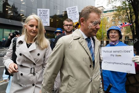 Craig Mackinlay with his wife, Kati arrives at Southwark Crown Court in London for a trial in connection with charges of illegal election spending during the 2015 general election.