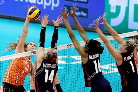 Stock Photo of Juliet Lohuis (L) of the Netherlands in action against US players Michelle Bartsch-Hackley (2-L), Foluke Akinradewo (2-R), and Micha Hancock (R) during the FIVB Women's World Championship third round Pool H match between the Netherlands and the USA in Nagoya, central Japan, 15 October 2018.