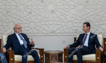 "In this photo released by the Syrian official news agency SANA, shows Syrian President Bashar Assad, right, meeting with Iraqi Foreign Minister Ibrahim al-Jaafari, in Damascus, Syria, . Al-Jaafari said Syria should not be isolated from its Arab neighbors, and lauded Damascus for staying ""strong"" and united in the face of many adversities"