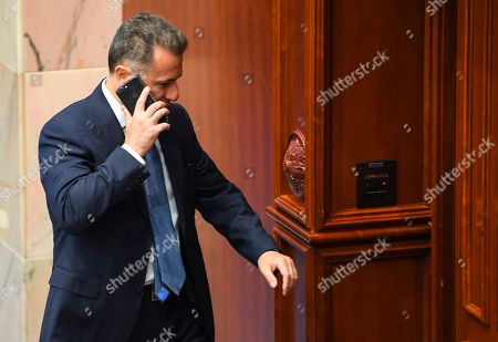 Stock Picture of Former Macedonian Prime Minister Nikola Gruevski leaves the parliamentary session for changing the state's constitution in Skopje, The Former Yugoslav Republic of Macedonia (FYROM), 15 October 2018. After the referendum held on September 30, the FYROM government submits a proposal to the parliament for the change of the state's constitution, to change the country's name to 'Republic of Northern Macedonia' to endorse a name deal between FYR of Macedonia and Greece and to qualify for NATO membership. It is necessary to have two third majority, (80 members of the parliament) to change the constitution of the state.