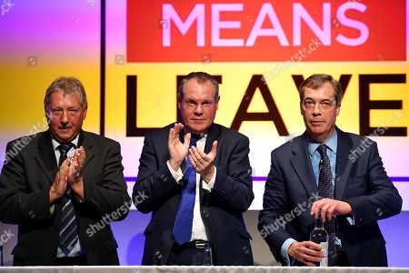 Nigel Farage MEP gives his speech at the Leave Means Leave rally to save Brexit at Bournemouth International Centre, (BIC), Dorset, UK. Pictured with DUP's Sammy Wilson MP, left and Conor Burns MP