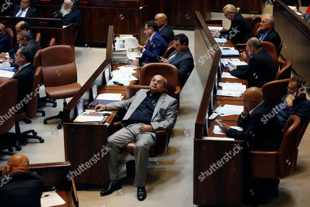 Israeli Arab of the MK block, Ahmad Tibi (front - C) listens to Prime Minister  Benjamin Netanyahu's speech, during the opening of the Winter session of the Israeli 'Knesset' parliament, in Jerusalem, Israel, 15 October 2018.