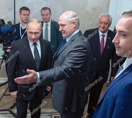 Russian President Vladimir Putin, Belarusian President Alexander Lukashenko and Chairman of the Council of the Republic of the National Assembly of Belarus Mikhail Myasnikovich during the meeting.