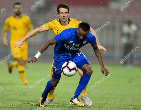 Kuwait's Dhari Said (front) in action against Australia's Robbie Kruse during the International friendly soccer match between Kuwait and Australia at Al kuwait club Stadium in Kuwait City, Kuwait, 15 October 2018.