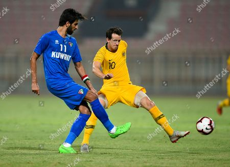 Kuwait's Fahd Ansari (L) in action against Australia's Robbie Kruse (R) during the International friendly soccer match between Kuwait and Australia at Al kuwait club Stadium in Kuwait City, Kuwait, 15 October 2018.
