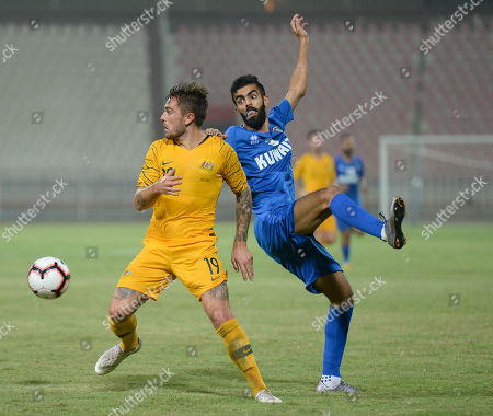 Kuwait's Ahmed Al Dhafiri  (R) in action against Australia's Josh Risdon (L) during the International friendly soccer match between Kuwait and Australia at Al kuwait club Stadium in Kuwait City, Kuwait, 15 October 2018.