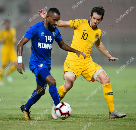 Kuwait's Dhari Said  (L) in action against Australia's Robbie Kruse (R) during the International friendly soccer match between Kuwait and Australia at Al kuwait club Stadium in Kuwait City, Kuwait, 15 October 2018.