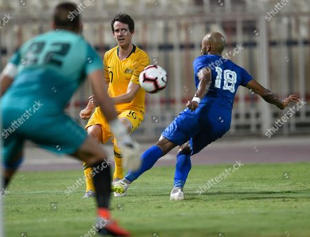 Kuwait's Amer Ma'atoug (L) in action against Australia's Robbie Kruse (C) during the International friendly soccer match between Kuwait and Australia at Al kuwait club Stadium in Kuwait City, Kuwait, 15 October 2018.