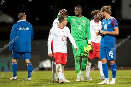 Switzerland's goalkeeper Yvon Mvogo (C) and teammate Xherdan Shaqiri (2-L) react after the UEFA Nations League soccer match between Iceland and Switzerland at the Laugardalsvoellur stadium in Reykjavik, Iceland, 15 October 2018.