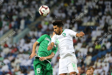 Stock Image of Saudi Housain Al-Mogahwi (L) in action against Iraq's Mahdy Kamel Shaltag (R) during the friendly international soccer match between Saudi Arabia and Iraq, in Riyadh, Saudi Arabia, 15 October 2018.