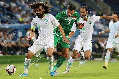 Saudi Arabia's Hussein Abdul-Ghani (L) in action against Iraq's Ahmed Yassin (C) chased by Saudui Arabia's Abdullah Otayf (R) during the friendly international soccer match between Saudi Arabia and Iraq, in Riyadh, Saudi Arabia, 15 October 2018.