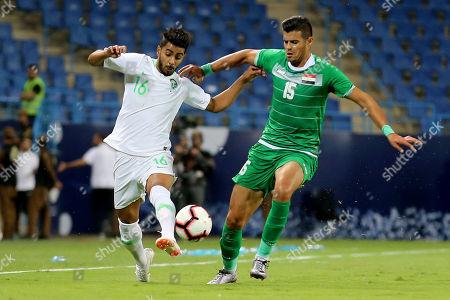 Saudi Arabia's Housain Al-Mogahwi (L) in action against Iraq's Raad Fanar during the friendly international soccer match between Saudi Arabia and Iraq, in Riyadh, Saudi Arabia, on 15 October 2018.