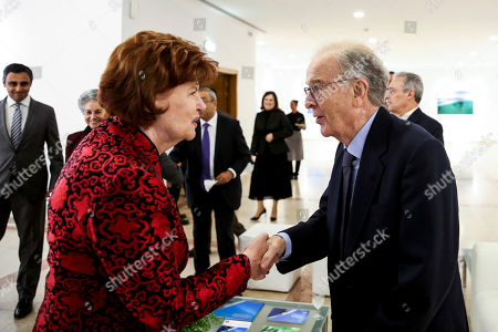 Former Portuguese President, Jorge Sampaio (R), greets Vaira Vike Freiberga during a dinner with 40 former heads of state at Ismaili Center, Lisbon, Portugal, 15 October 2018.