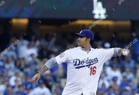 Stock Photo of Andre Ethier throws the ceremonial first pitch before Game 3 of the National League Championship Series baseball game between the Milwaukee Brewers and the Los Angeles Dodgers, in Los Angeles
