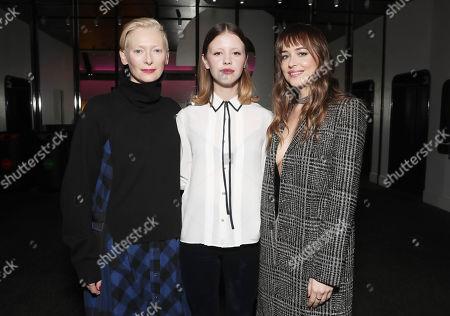 (L-R) Tilda Swinton, Mia Goth, Dakota Johnson