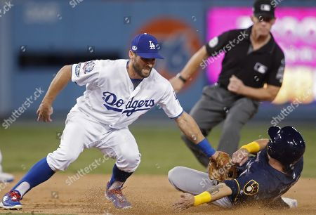Milwaukee Brewers third baseman Hernan Perez (R) is tagged out by Los Angeles Dodgers center fielder Chris Taylor (L) in the ninth inning of the MLB National League Championship Series baseball game three between the Milwaukee Brewers and the Los Angeles Dodgers at Dodger Stadium in Los Angeles, California, USA, 15 October 2018.