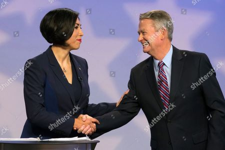 Democratic gubernatorial candidate Paulette Jordan and Lt. Gov. Brad Little shake hands after a debate at the studios of Idaho Public Television in Boise, Idaho