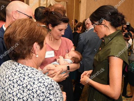 Meghan Duchess of Sussex talks to Australian singer Missy Higgins, with her 9 week old baby Lunar, during an afternoon reception hosted by the Governor-General and Lady Cosgrove at Admiralty House, Sydney