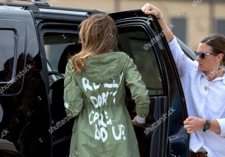 "First lady Melania Trump arrives at Andrews Air Force Base, Md., wearing a jacket that reads ""I REALLY DON'T CARE, DO U?"" after visiting a children's center in McAllen, Texas. A Melania Trump spokeswoman is asking people to boycott Atlanta rapper T.I. because of his promotional album video that shows a woman resembling the first lady stripping in the oval office. WXIA-TV reports the director of communications for Melania Trump, Stephanie Grisham, tweeted Saturday asking how the video was acceptable"