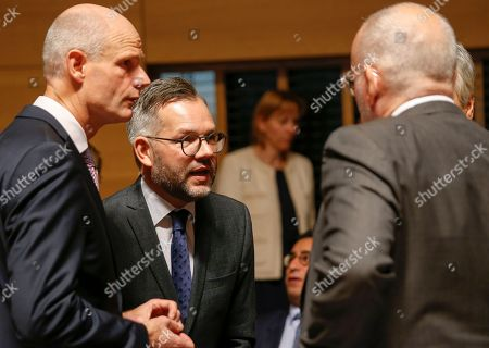 Stock Picture of (L-R) Dutch Foreign Minister Stef Blok, German Minister of State for European Affairs Michael Roth, Belgiuan Foreign Minister Didier Reynders (hidden behind) and European Commission Vice President Frans Timmermans discuss a point  at the start of the General Affairs Council meeting in Luxembourg, 16 October 2018. The ministers will continue with the preparations for the upcoming European Council on 18 October 2018 by examining draft conclusions.