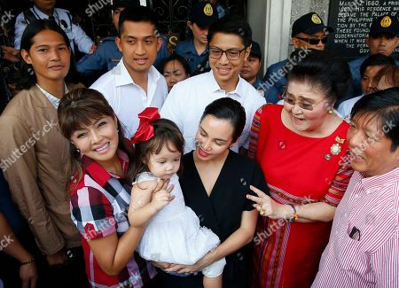 Imee Marcos, Imelda Marcos, Ferdinand Marcos Jr., Borgy Marcos, Mathew Marcos, Michael Marcos, Mia Marcos, Cara Marcos. Governor Imee Marcos, left, the daughter of the late strongman Ferdinand Marcos, poses with her family upon arrival at the Commission on Elections to file her Certificate of Candidacy or COC for a Senate seat in the May 2019 midterm elections, in Manila, Philippines. Close to a hundred senatorial hopefuls have so far filed their certificates of candidacy for the 13 senatorial seats available for next year's elections. With her are her children (from left second row) Borgy, Mathew and Michael, her mother Imelda Marcos and brother Ferdinand Marcos Jr. In front is her granddaughter Mia and daughter-in-law, Cara