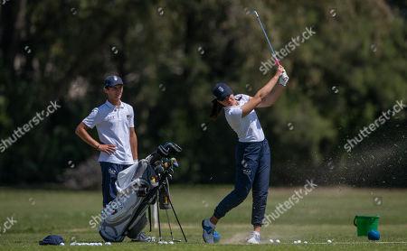 Stock Picture of Alessia Nobilio ITA and Andrea Romano ITA on the golf practice range at Hurlingham Club.