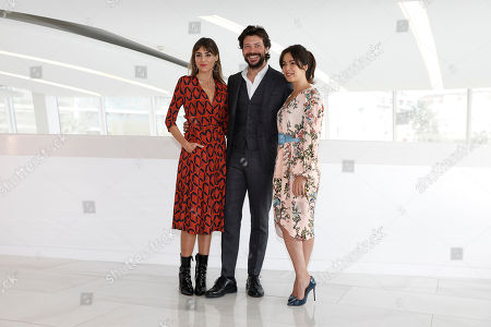 Spanish actors Irene Arcos (L), Alvaro Morte (C) and Veronica Sanchez (R) pose during a photocall for the TV series 'The Pier' at the annual MIPCOM television content market in Cannes, France, 16 October 2018. The media event runs from 15 to 18 October.