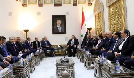 Stock Image of Syrian Speaker Hammoudeh Sabbagh (C-R) meets with Prime Minister of Crimea Sergei Aksyonov (C-L) in Damascus, Syria, 16 October 2018. Aksyonov, who is on a current visit to Syria, met earlier on the same day with Syrian President Bashar Assad.
