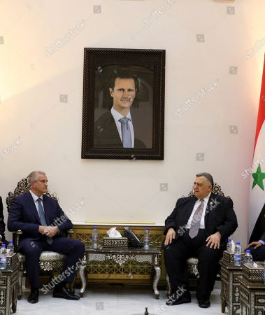Stock Photo of Syrian Speaker Hammoudeh Sabbagh (R) meets with Prime Minister of Crimea Sergei Aksyonov (L) in Damascus, Syria, 16 October 2018. Aksyonov, who is on a current visit to Syria, met earlier on the same day with Syrian President Bashar Assad.