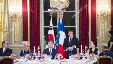 Stock Picture of French President Emmanuel Macron, his wife Brigitte Trogneux, South Korean President Moon Jae-In and his wife Kim Jung-sook during a state dinner at the Elysee Presidential Palace in Paris