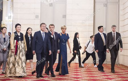 Stock Photo of French President Emmanuel Macron, his wife Brigitte Trogneux, South Korean President Moon Jae-In and his wife Kim Jung-sook arrives for a state dinner at the Elysee Presidential Palace in Paris