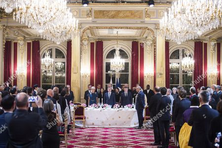 French President Emmanuel Macron, his wife Brigitte Trogneux, South Korean President Moon Jae-In and his wife Kim Jung-sook during a state dinner at the Elysee Presidential Palace in Paris